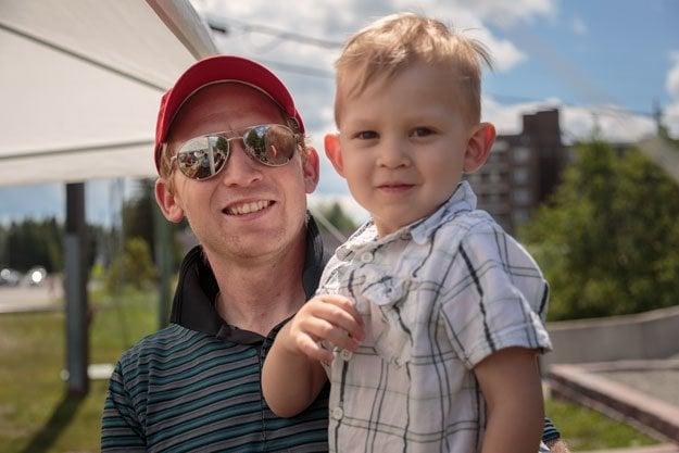 a father and son outside the church in Kirkland Lake